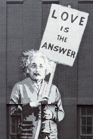 Graffiti - Einstein holds up a placard saying LOVE IS THE ANSWER